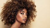 istock Afro beauty. Curious and sharp look at the viewer. Girl with vibrant, melanin-rich skin tone. 1296099200