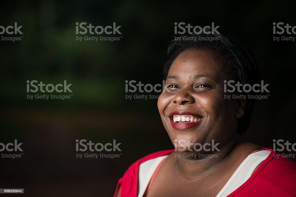 Afro brazilian woman looking happy stock photo