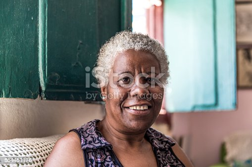 istock Afro Brazilian woman smiling at home 854451176