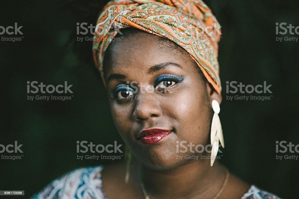 Afro brazilian woman wearing african head scarf stock photo