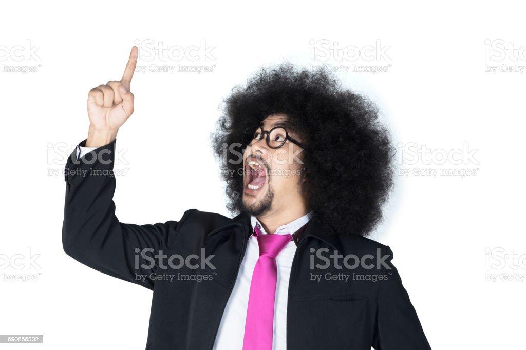 Afro businessman pointing to upward stock photo