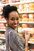 Afro caribbean housewife buying fruit in a supermarket