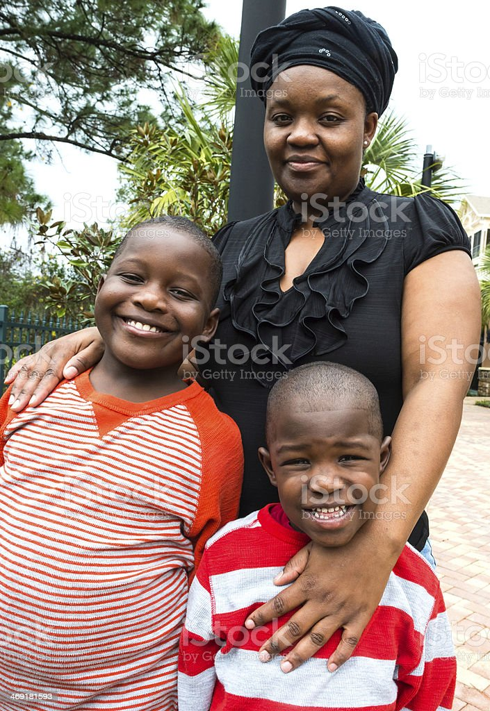 Afro caribbean mother and children stock photo