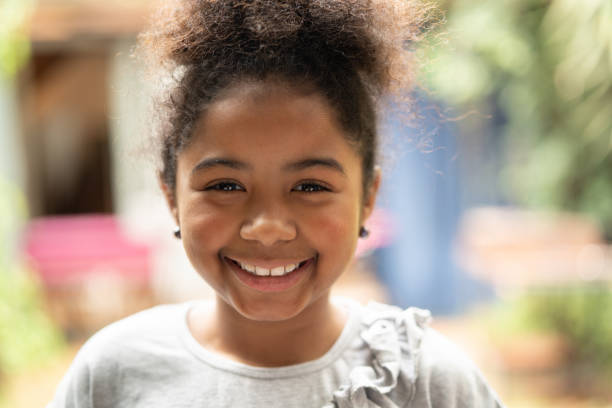Afro child smiling portrait I am really happy 8 9 years stock pictures, royalty-free photos & images