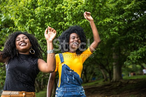182677415 istock photo Afro descent girls dancing in the park 888856956