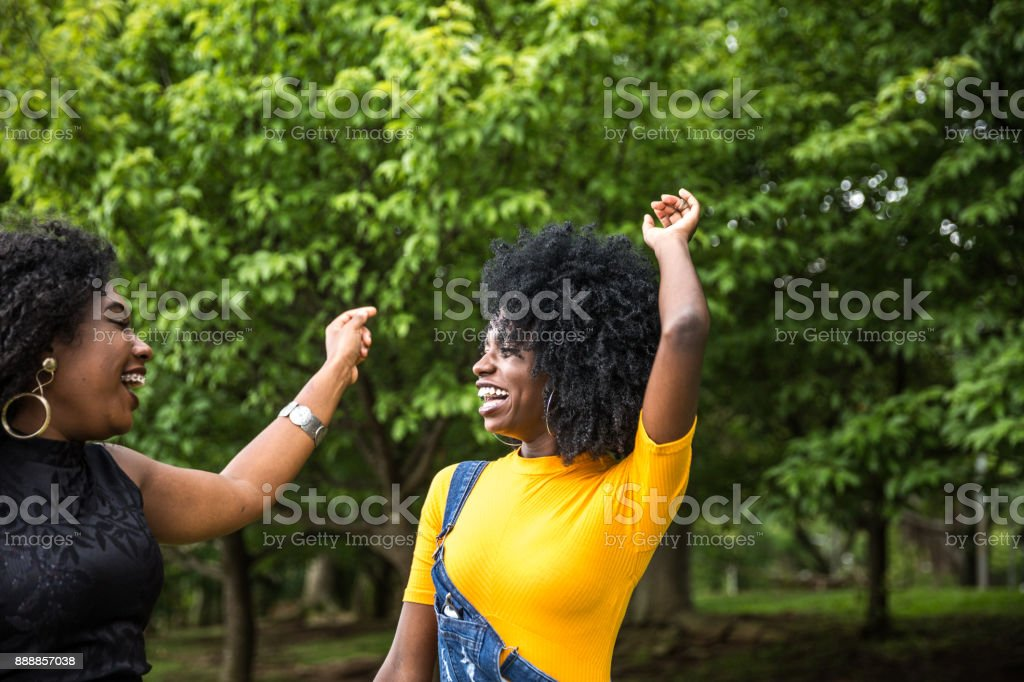 Afro descent girls dancing in the park stock photo