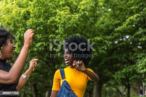 182677415 istock photo Afro descent girls dancing in the park 888857094