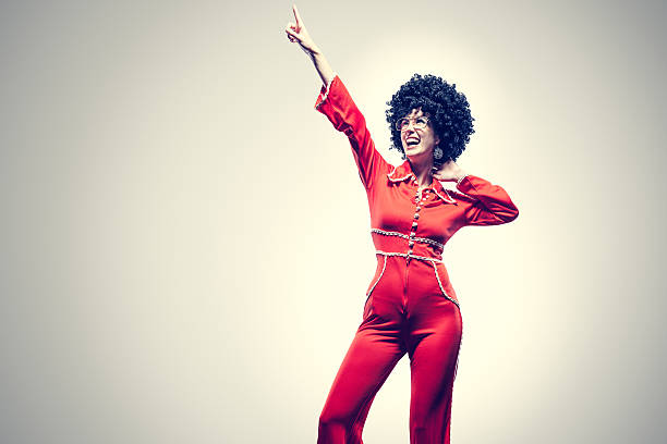 afro disco dancer with jumpsuit - disco dancing stock photos and pictures