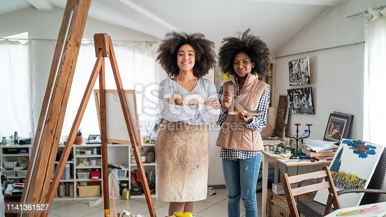 824254912 istock photo Afro Female fine artists drawing in studio 1141361527