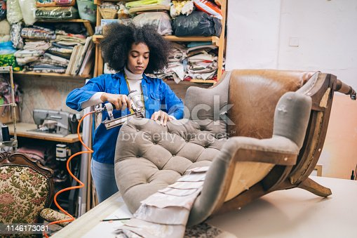 Afro Female Small Business Owner Refurbishing Chair In Upholstery Workshop
