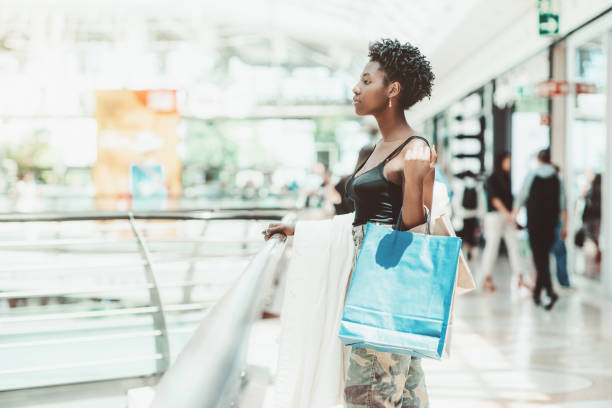 Afro female with bags in shopping stock photo