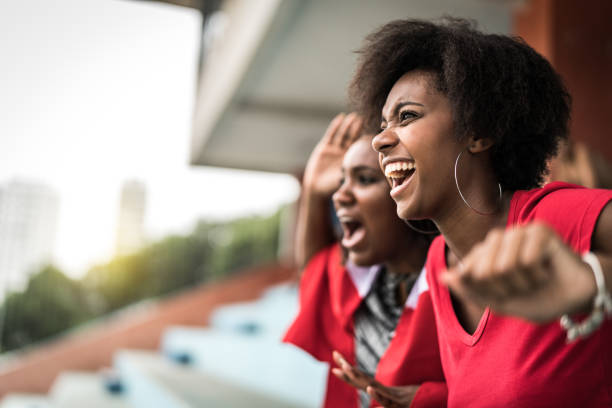 afro friends watching a soccer game - game of life stock photos and pictures