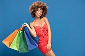 istock Afro girl enjoying shopping sales. 996545652