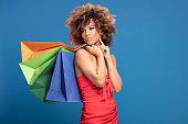 istock Afro girl enjoying shopping sales. 996545740