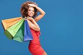 istock Afro girl enjoying shopping sales. 996547942