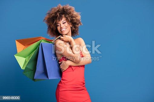 istock Afro girl enjoying shopping sales. 996548000
