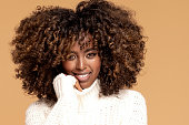 istock Afro girl in cozy fashionable sweater. 1271214816