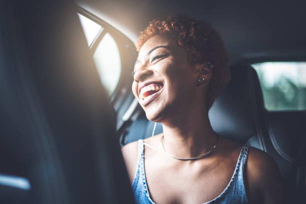 Afro girl inside a car stock photo