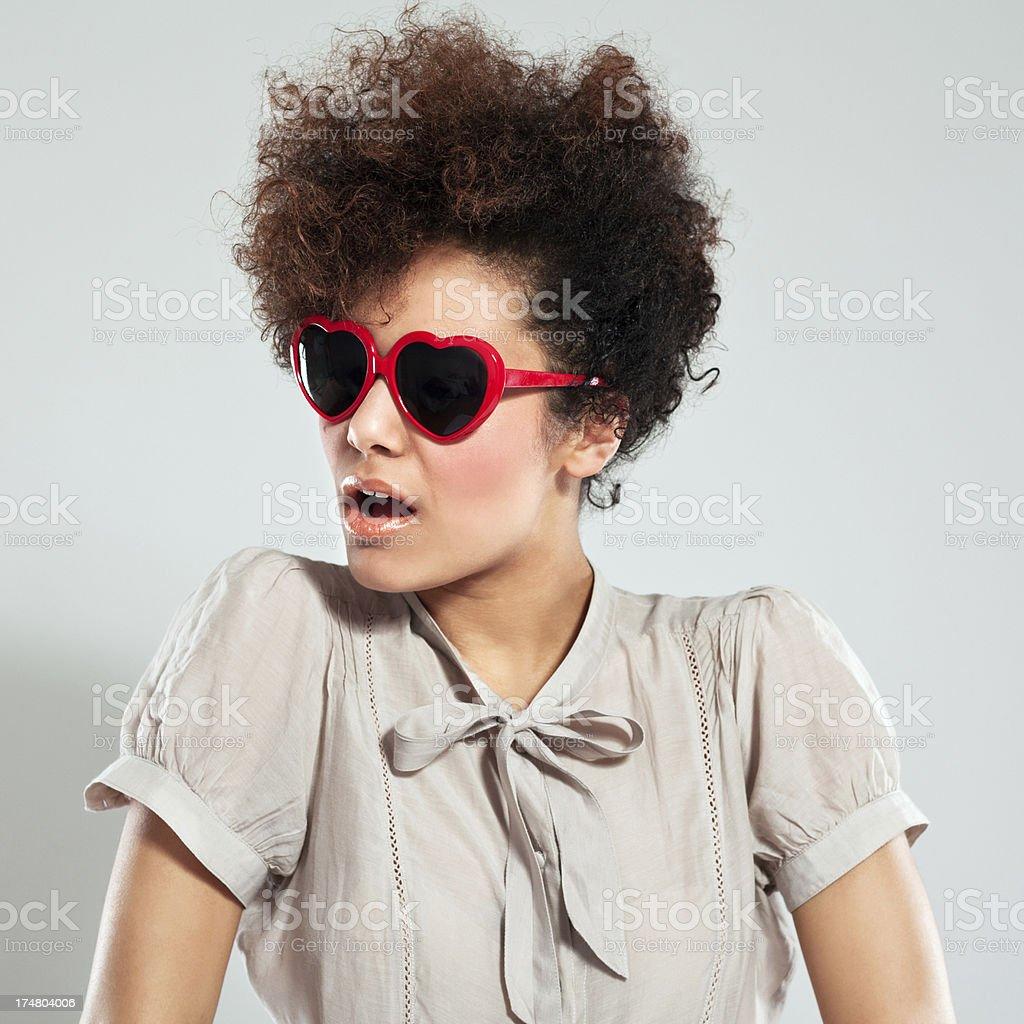 Afro Girl Portrait Portrait of teenaged afro girl wearing heart shaped glasses. Studio shot, grey background. 18-19 Years Stock Photo