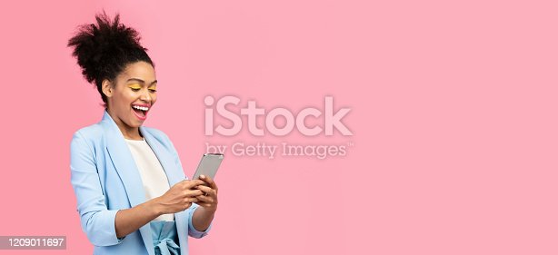 istock Afro girl using her mobile phone at studio 1209011697