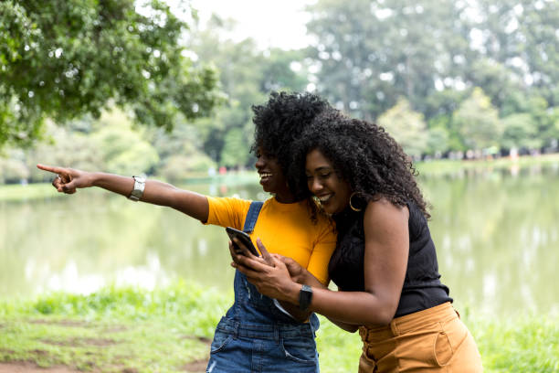 afro girl using the maps on the phone - kenyan culture stock photos and pictures
