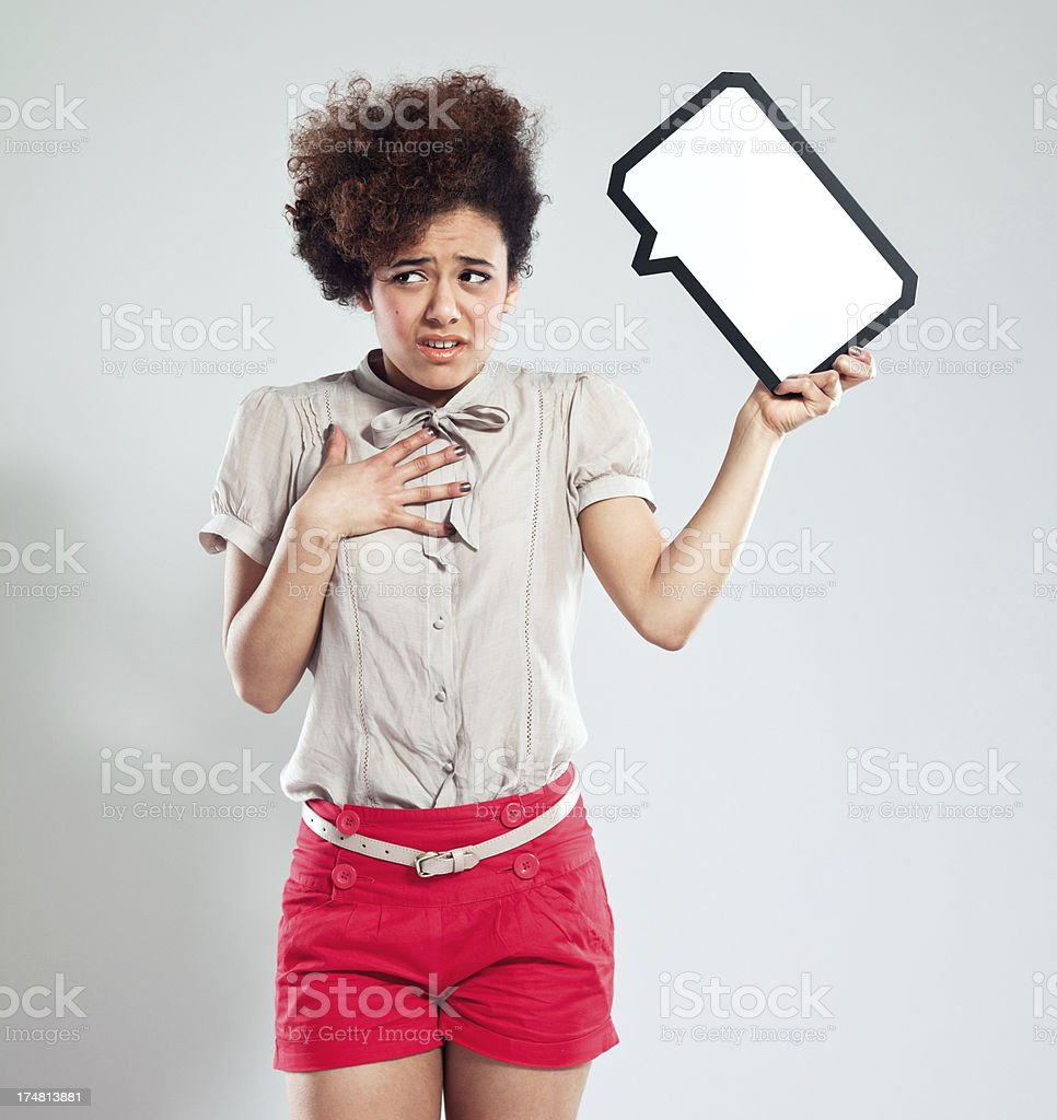 Afro Girl with speech bubble Worried Afro Girl holding speech bubble next to her head. 18-19 Years Stock Photo