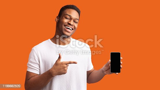 istock Afro guy showing blank black cellphone screen 1199662520