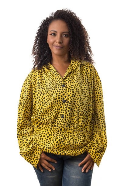 afro hair black brazilian girl looking happily in camera Portrait of afro hair black brazilian girl looking happily in camera. Standing against white background. medium shot stock pictures, royalty-free photos & images