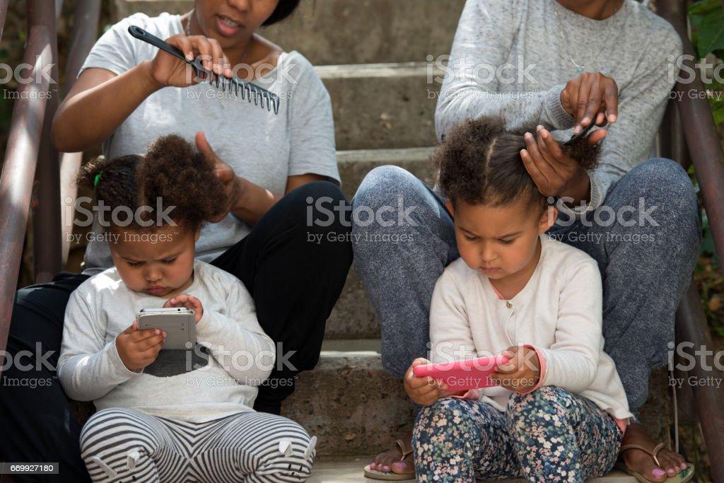 Afro hair lifestyle in childhood urban neighborhood. stock photo