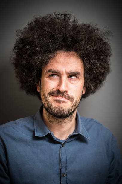afro hair man - crotchety stock pictures, royalty-free photos & images