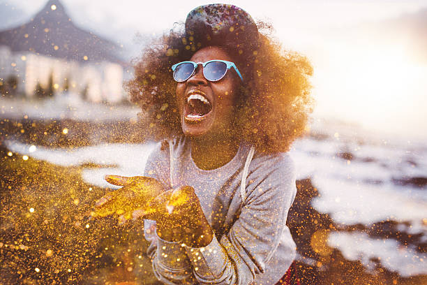 Afro hipster girl laughing ecstatically while throwing gold glitter picture id469247014?b=1&k=6&m=469247014&s=612x612&w=0&h=rt4uahwl80dwfyrncc2ynnftxecju77ixtolubdxoha=
