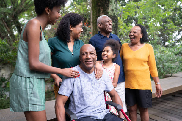 Afro hispanic-latino multi-generation family, and one of them on wheelchair portrait stock photo