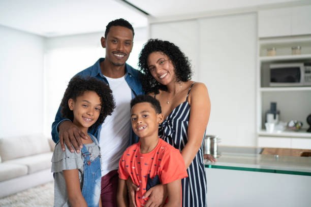 Afro Latin Family Portrait at Home Afro Latin Family Portrait at Home brazilian ethnicity stock pictures, royalty-free photos & images