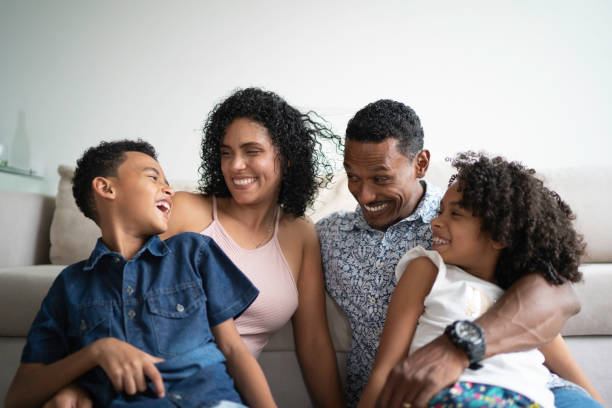 Afro Latin Family Portrait at Home Afro Latin Family Portrait at Home four people stock pictures, royalty-free photos & images