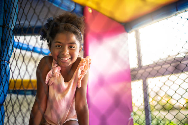 Afro latinx girl playing at playground portrait Childhood afro caribbean ethnicity stock pictures, royalty-free photos & images