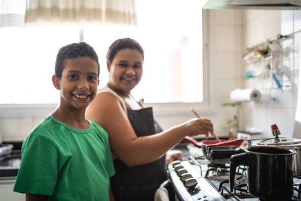 Afro latinx mother and son cooking at home portrait Domestic Life brazilian culture stock pictures, royalty-free photos & images