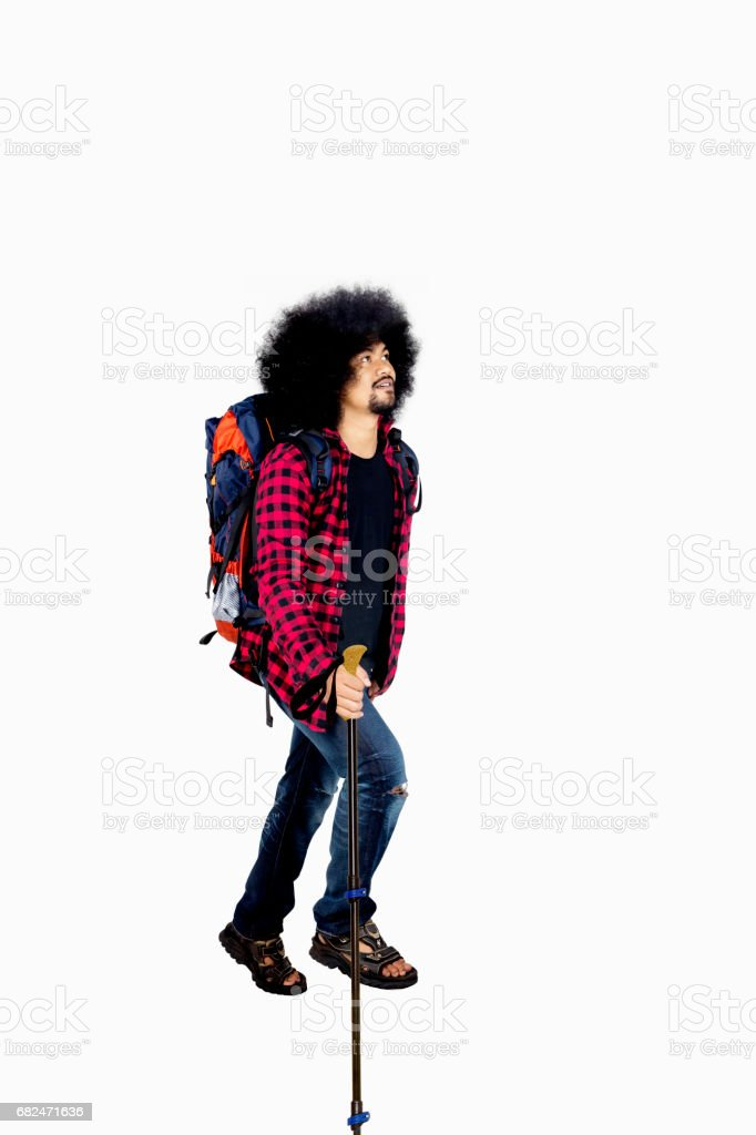 Afro man walks with a stick pole Стоковые фото Стоковая фотография