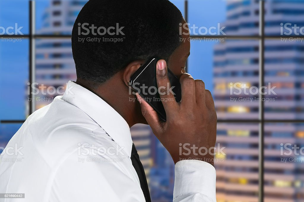 Afro man with mobile phone. stock photo