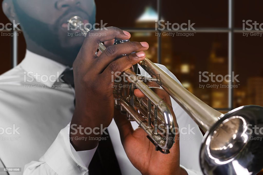Afro man's hand on trumpet. stock photo