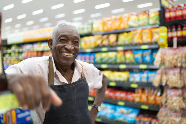 Afro senior man business owner employee at supermarket picture id1128887915?b=1&k=6&m=1128887915&s=612x612&w=0&h=tqcmycel2wifrhho dina05maqjidfiowyrbftw5fkq=