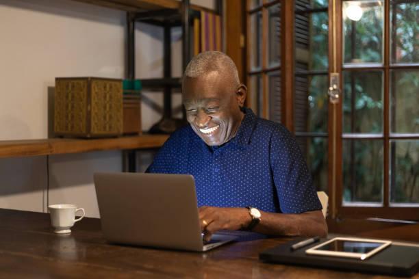 Afro senior man working at home picture id1090798704?b=1&k=6&m=1090798704&s=612x612&w=0&h=v7tgd wwdygmm6vklletrlp9zvk44yyzabwdkcncxo4=