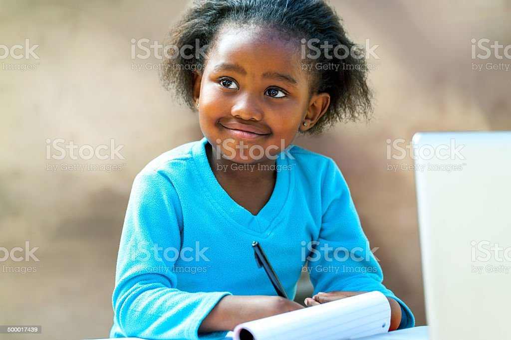 Afro student doing schoolwork. stock photo