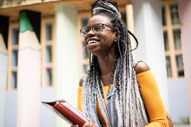Afro Student/Teacher On the Move Real Life afro caribbean ethnicity stock pictures, royalty-free photos & images