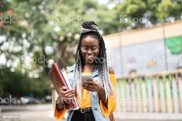 Afro studentteacher on the move with mobile picture id962985304?b=1&k=6&m=962985304&s=612x612&h=h5t7q2rgmp6hkbytew4oajspzjowakua0qkpn54mryi=
