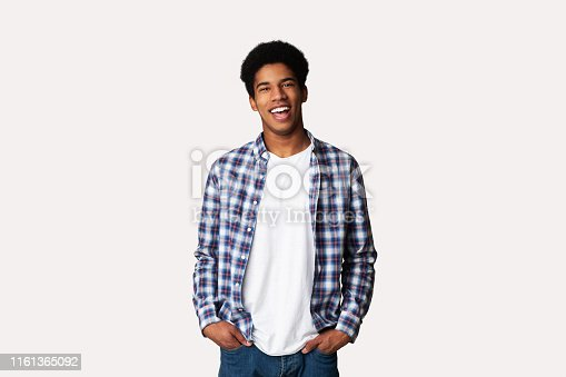 istock Afro Teenage Guy Posing with Hands in Pockets 1161365092