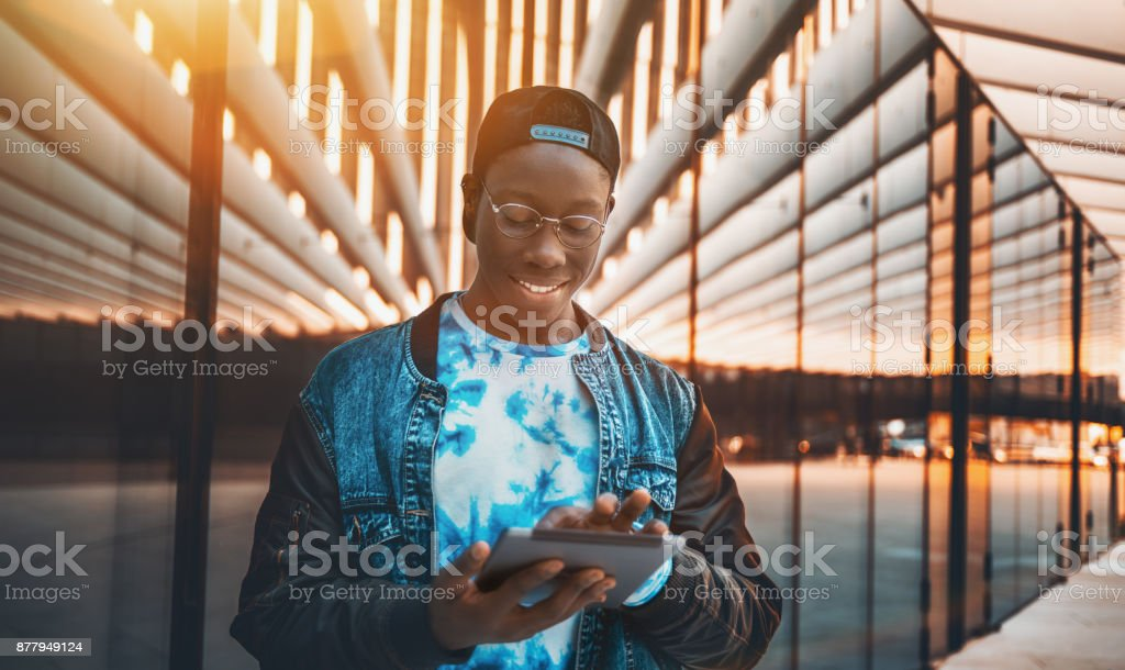 Afro undergraduate man with digital tablet stock photo