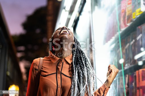 istock Afro Woman Celebrating 959242594