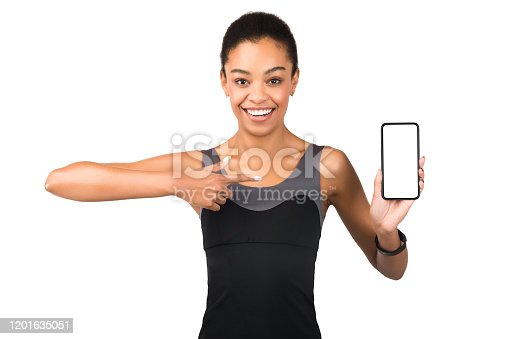 1132512759 istock photo Afro Woman Showing Smartphone Empty Screen Pointing Finger, White Background 1201635051