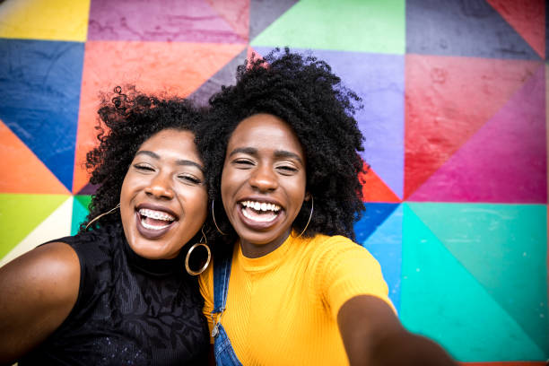 Afro women descent taking selfie photos in the park stock photo