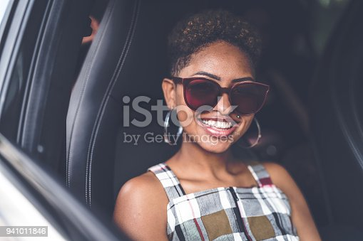 istock Afro young descent woman inside a luxury car 941011846
